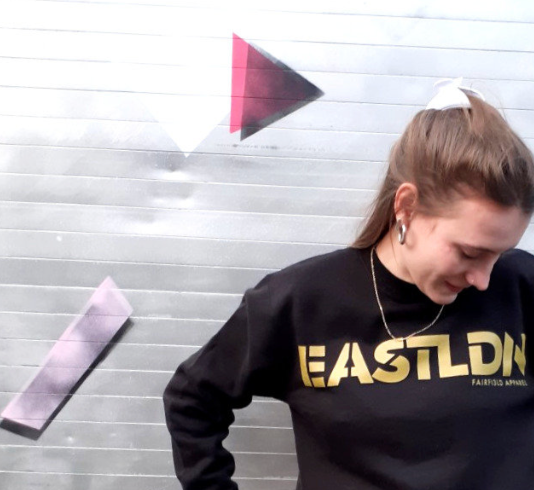 EASTLDN Black Sweater large GOLD logo on chest
