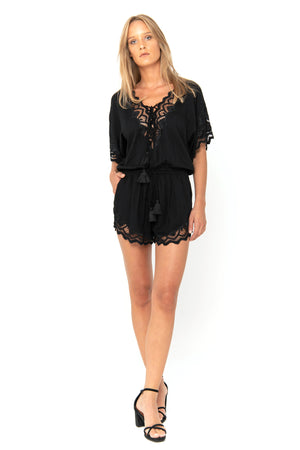 Black short playsuit with draw string waist and handmade embroidery details
