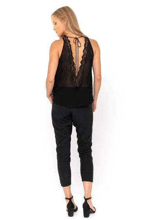 Black sleeveless top with handmade embroidery details.