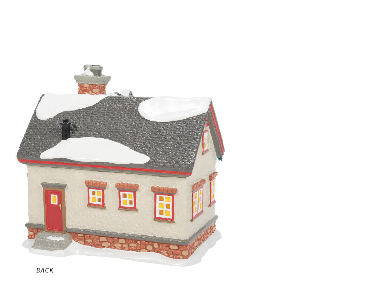 The Peanuts House lit building back view