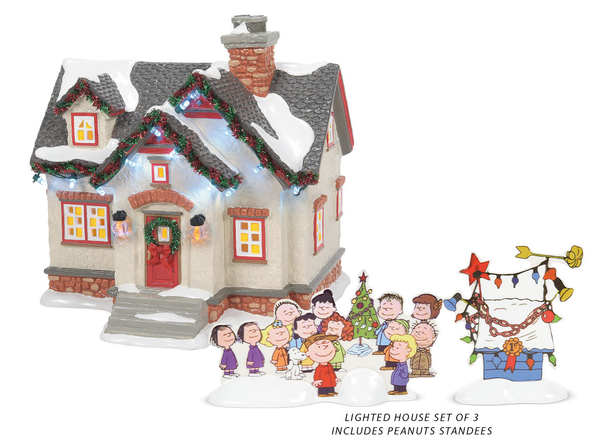 The Peanuts House lit building with standee figurines