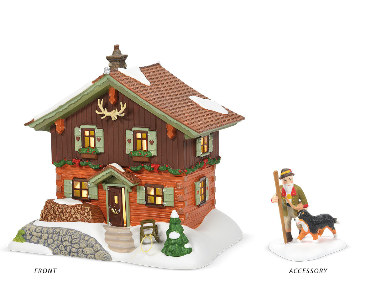 Opa's Cabin lit building and Bavarian Trail Guide figurine