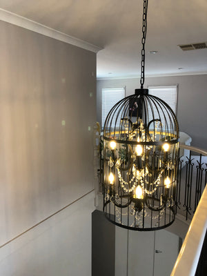 bird cage country style crystal chandelier in a house