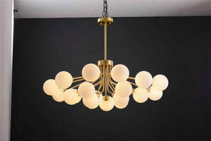 Gold Linear Chandeleir & Wall Scone. - Aglaia lighting