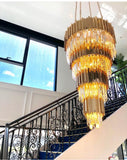 brass castle full filled crystal chandelier next to staircase