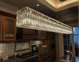 1899s surrounded crystal chandelier in kitchen