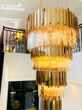 brass castle full filled crystal chandelier at entrance