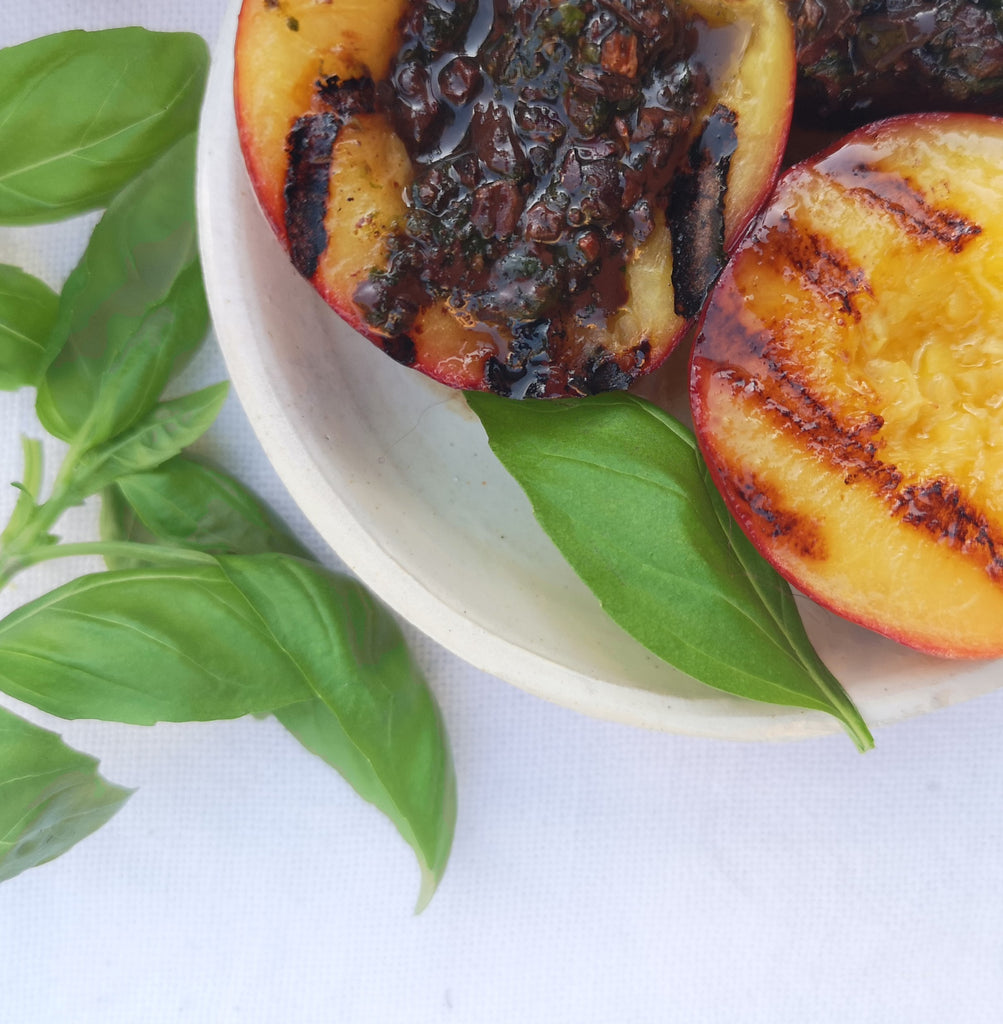 Grilled Nectarines with Cocoa Nib, lime  and Finca la Torre Pesto