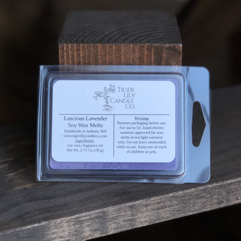 Luscious Lavender scented soy melts in clamshell against dark wood background