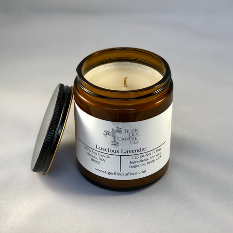 lavender scented soy candle in amber jar with black lid and white label