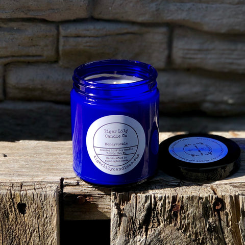 Soy candle in cobalt blue glass jar honeysuckle fragrance