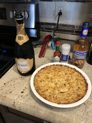 Caramelized Onion Dip with bacon, on countertop with Champagne and hot sauce