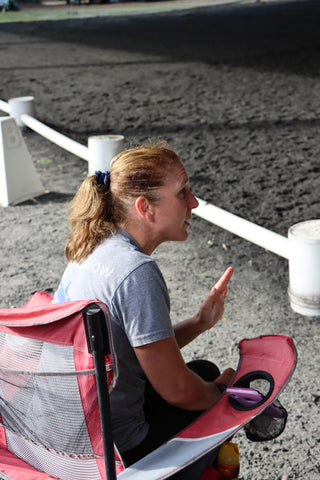 Woman Sitting in Chair teaching riding lesson