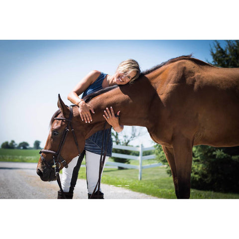 Woman and bay horse