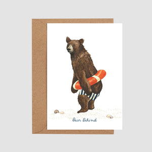 Bear behind card flat with envelope