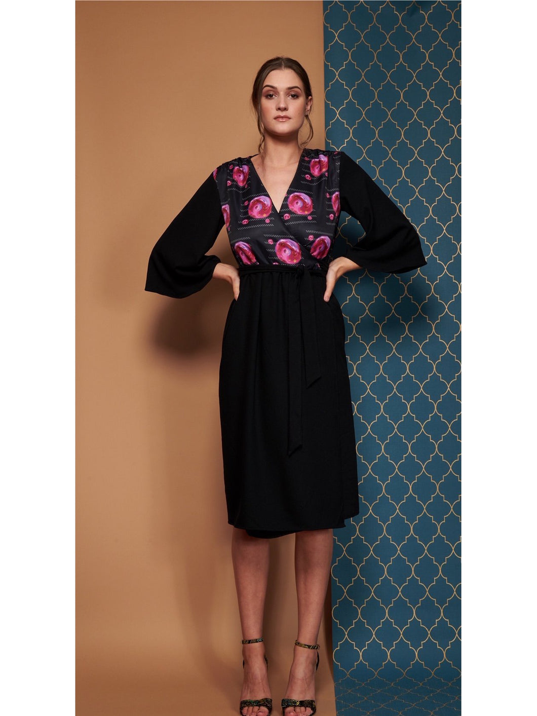 Pearl Wrap dress in black with Geranium planet print detail.