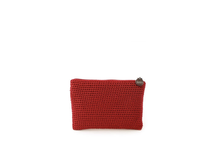 Red full crochet purse with silver zipper and circle shaped silver charm with Dowa branding