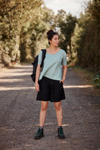 Woman wearing the Asmuss Aline T-shirt in Sea Green.  A great top for the outdoors or indoors as it helps regulate your body temperature