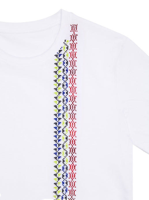 hand embroidered white t shirt made by refugees