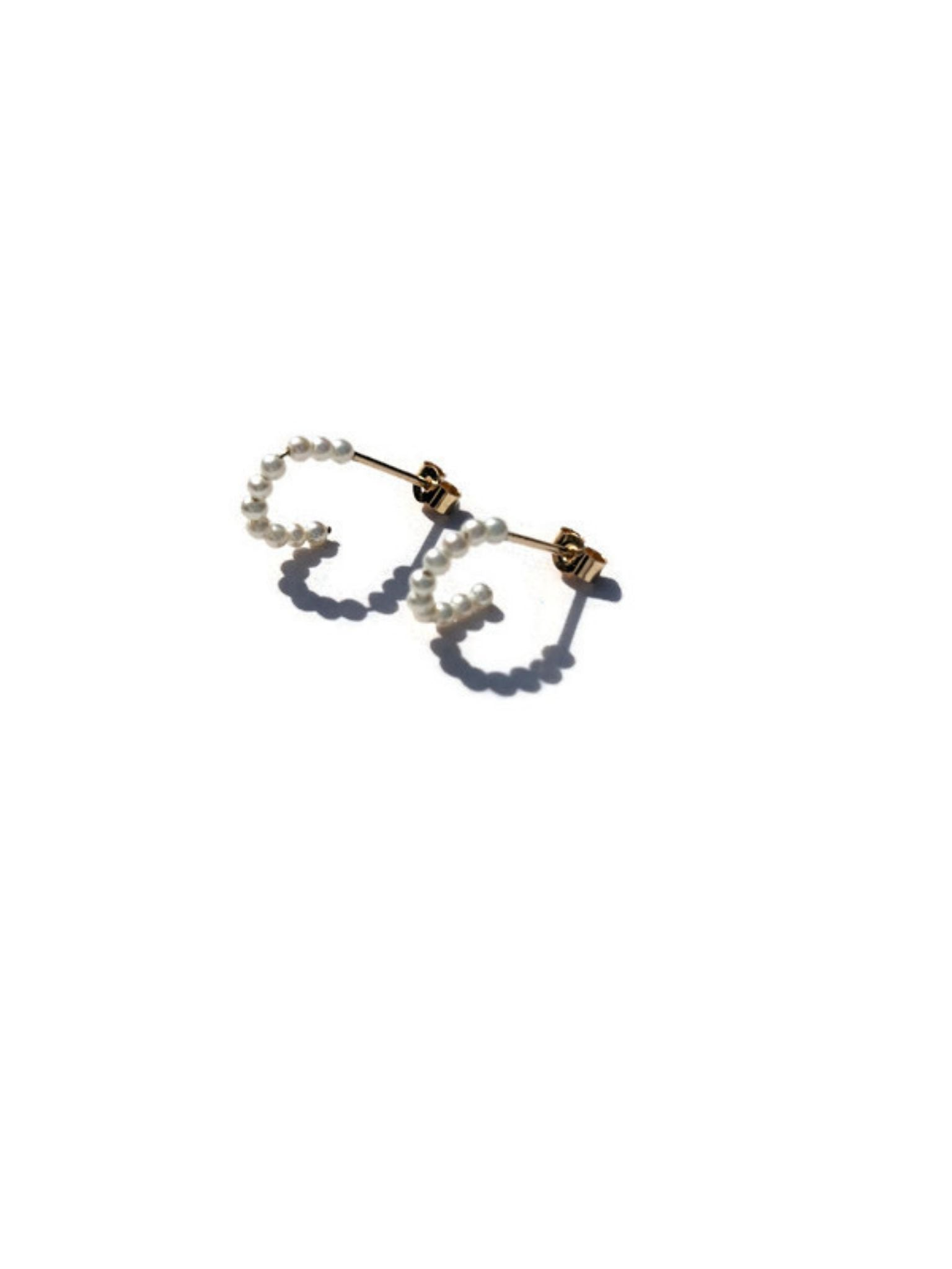 Tiny pearl hoops in 9ct gold