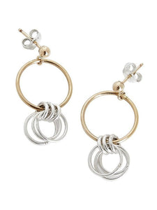 Stud earrings with circles in gold and silver