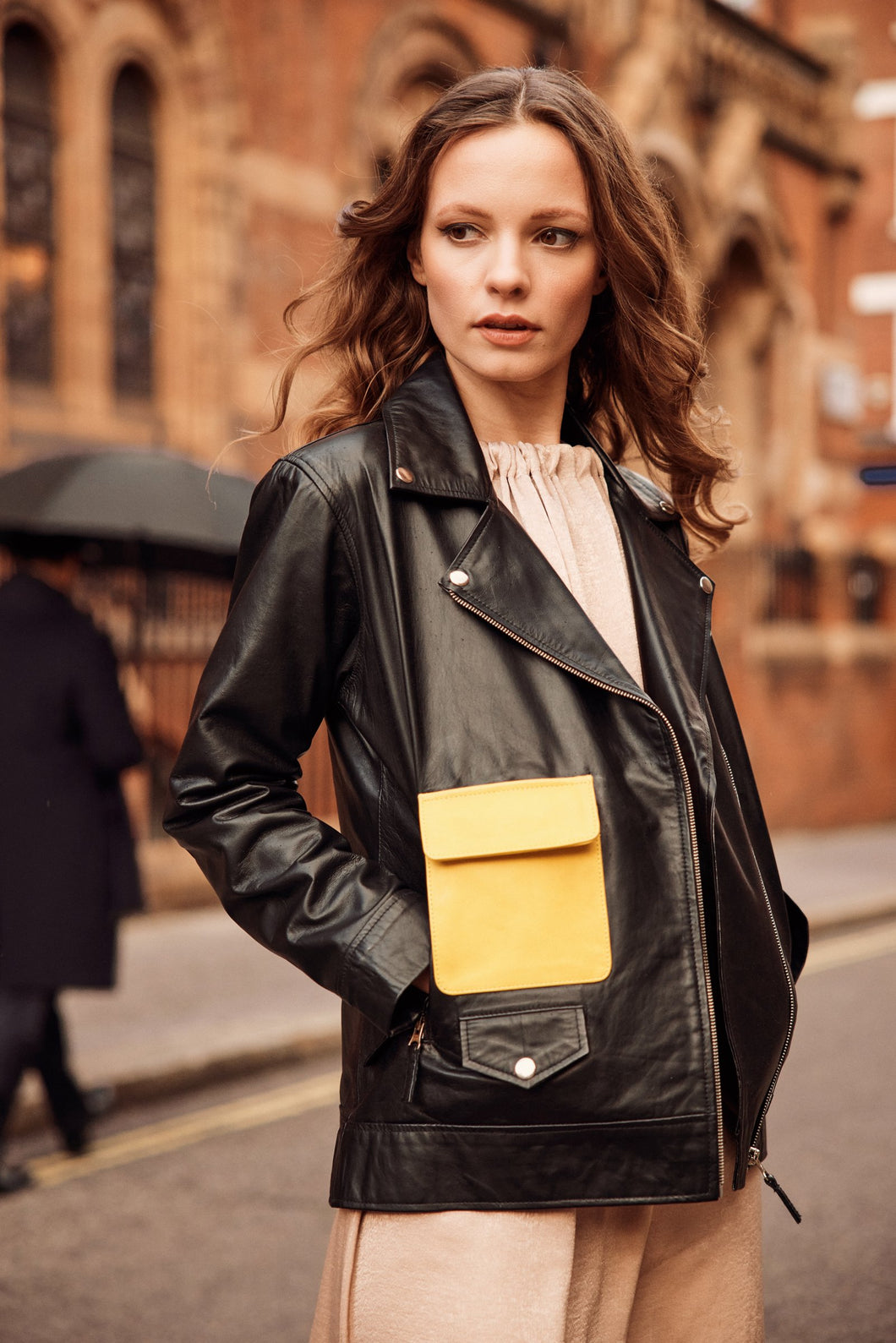 Black leather jacket with yellow pocket