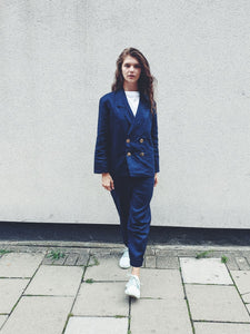 Double breasted Ethically Made Navy Linen Suit with roll up trousers and a high waist. Made by ethical clothing brand Fanfare Label