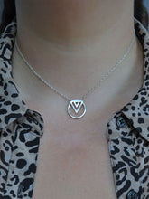 silver enso geometric necklace on model