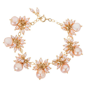 Venus pink pearl dangle bracelet is handmade with 18k gold by Amadeus
