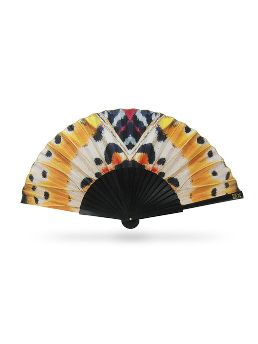 Mighty Monarch butterfly print hand-fan from Khu Khu. Symmetrical print with yellows and oranges with black wooden sticks and gold detailing.
