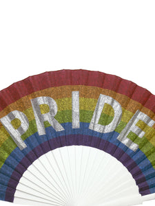 Close up of Khu Khu Pride Hand-Fan. hand-painted sparkly letters on rainbow print fabric mounted onto white painted wooden sticks with red painted rim and silver rivets, silver logo.