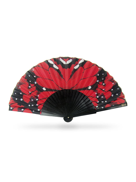 Red Papillon Hand-fan from Khu Khu. Red and black symmetrical print of butterfly wing close up with black wooden sticks and gold detailing.