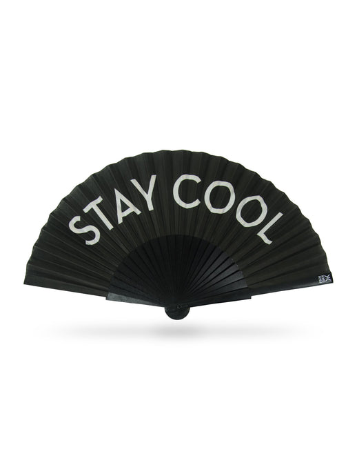 Khu Khu Stay Cool Hand-Fan. White letters on black cotton fabric mounted onto black painted wooden sticks with black painted rim and rivets, white logo.