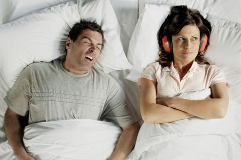 snoring husband in bed with wife upset