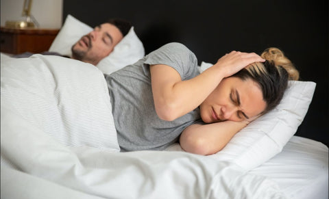 lady trying to sleep while husband is snoring