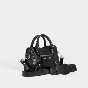 Side view of BALENCIAGA Mini City Bag With Silver Hardware in Black Leather and Shoulder Strap