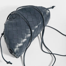 Load image into Gallery viewer, Top view of BOTTEGA VENETA Pouch 20 Intrecciato Crossbody in Deep blue Leather