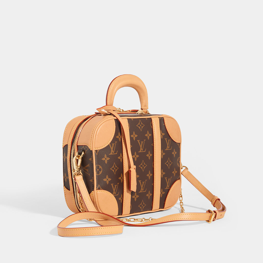 Side view of LOUIS VUITTON Monogram Valisette PM Top Handle Bag in Brown With Shoulder Strap