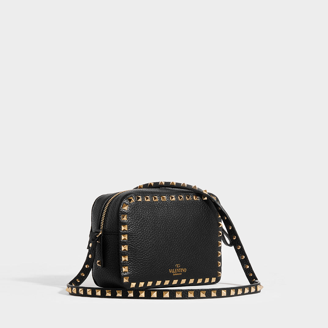Side view of VALENTINO Rockstud Leather Camera Bag in Black