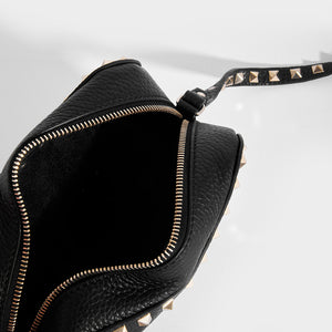 Inside of VALENTINO Rockstud Leather Camera Bag in Black