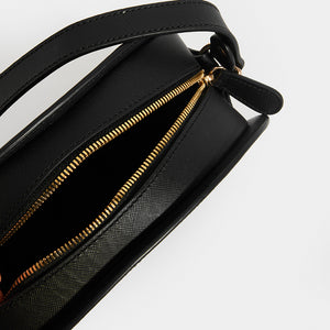 Zip and inside view of APC Half Moon Saffiano Leather Crossbody in Black