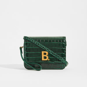 Dark Green BALENCIAGA B Small Bag in Croc-Embossed Calfskin with cross body strap and gold Balenciaga B logo on the front
