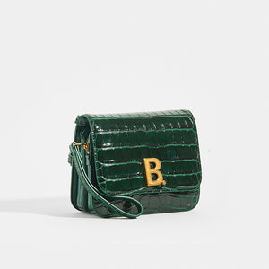 Side view of BALENCIAGA B Small Bag in Croc-Embossed Calfskin in Dark Green