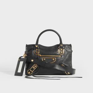 BALENCIAGA Mini City Bag With Gold Hardware in Black Leather with top handles and cross body strap - Front View