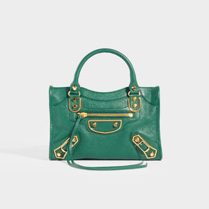 BALENCIAGA Mini City Bag With Gold Hardware in Forest Green Leather with top handles and leather cross body strap