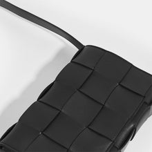Load image into Gallery viewer, Top of BOTTEGA VENETA Cassette Maxi Intrecciato Bag in Black Leather