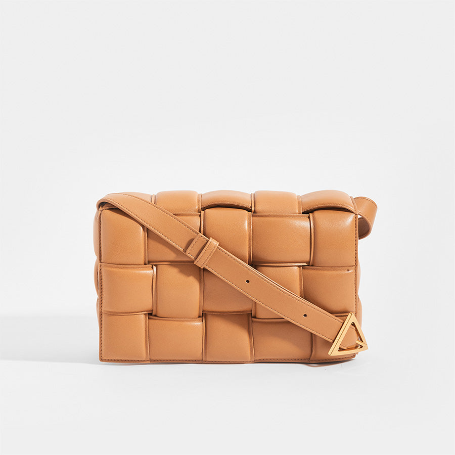 Front view of BOTTEGA VENETA Padded Cassette Crossbody Bag in Caramel Lambskin Leather