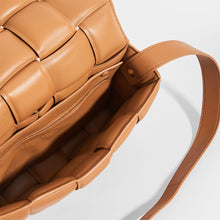 Load image into Gallery viewer, Inside view of BOTTEGA VENETA Padded Cassette Crossbody Bag in Caramel Lambskin Leather