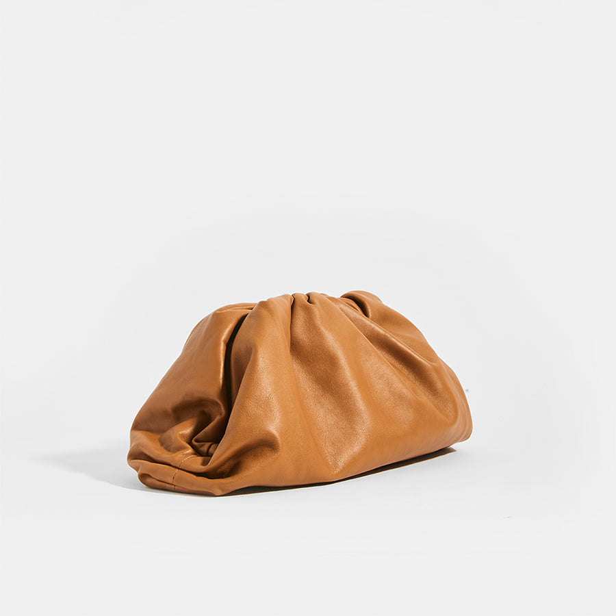 Side view of BOTTEGA VENETA Tan Large Pouch