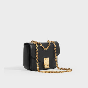 Side view of CELINE Small C Bag in Polished Black Calfskin